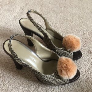 heels with puff ball!